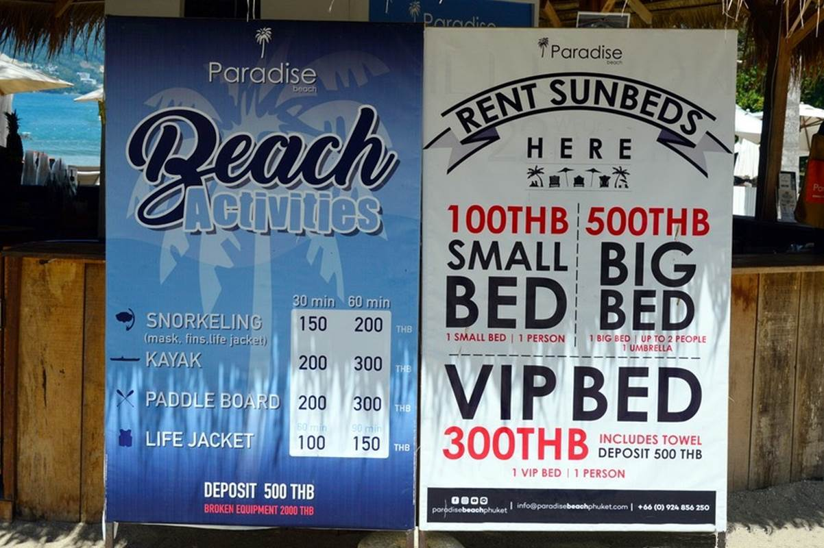 Paradise Beach | Billboard with rates for sunbeds