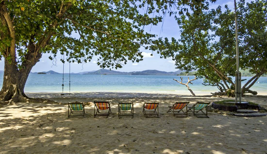 View of deck chairs facing the ocean on Koh Lawa Yai Island Beach