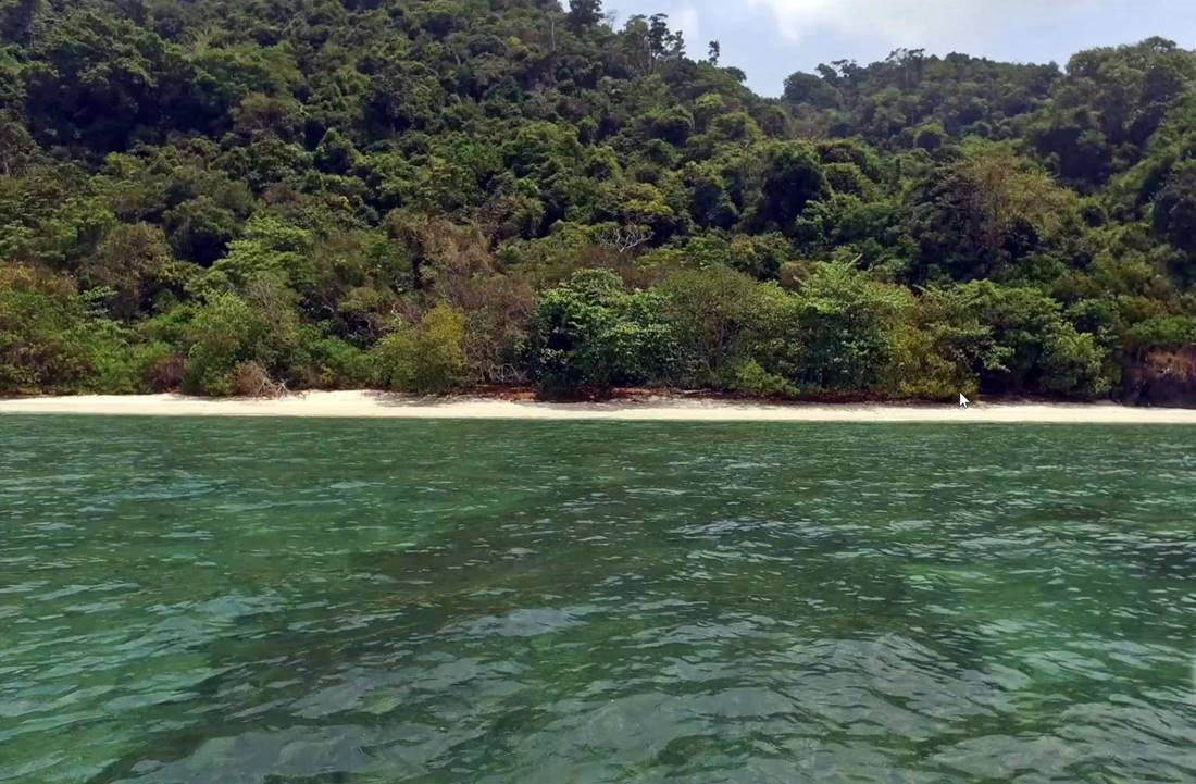 View from the boat of a sandy beach on Koh Lon Island east coast